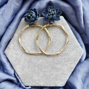 Pendientes de aro dorados flor